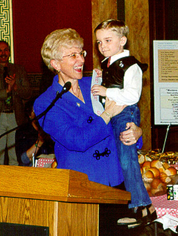 Governor Judy Martz holds Seth Robertus during the 2001 Agricultural Appreciation Legislative Luncheon